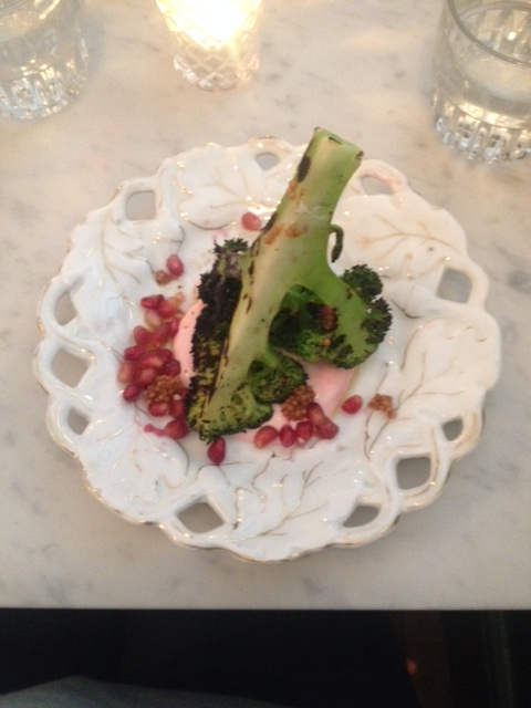 Broccoli with pomegranate yoghurt dressing