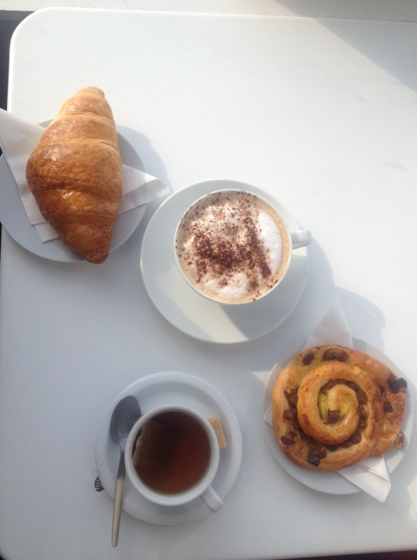 Croissant, Cappucino, apple and cinnamon tea and a pain au raisin