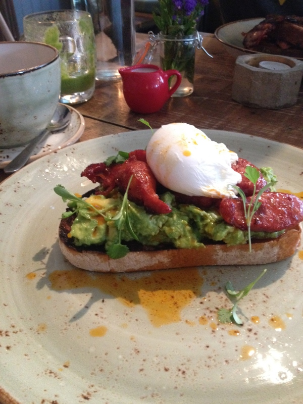 Avocado, egg and chorizo on toast