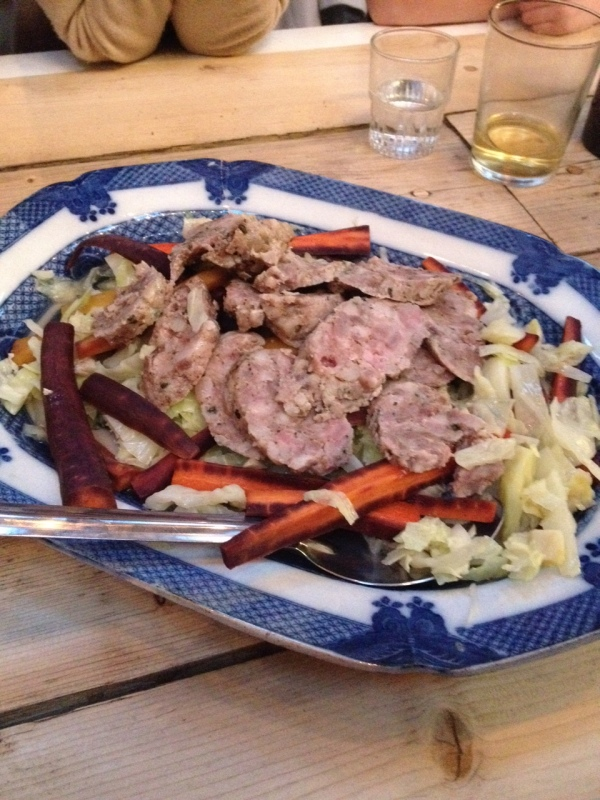 Homemade sausage served with cabbage and carrot to start